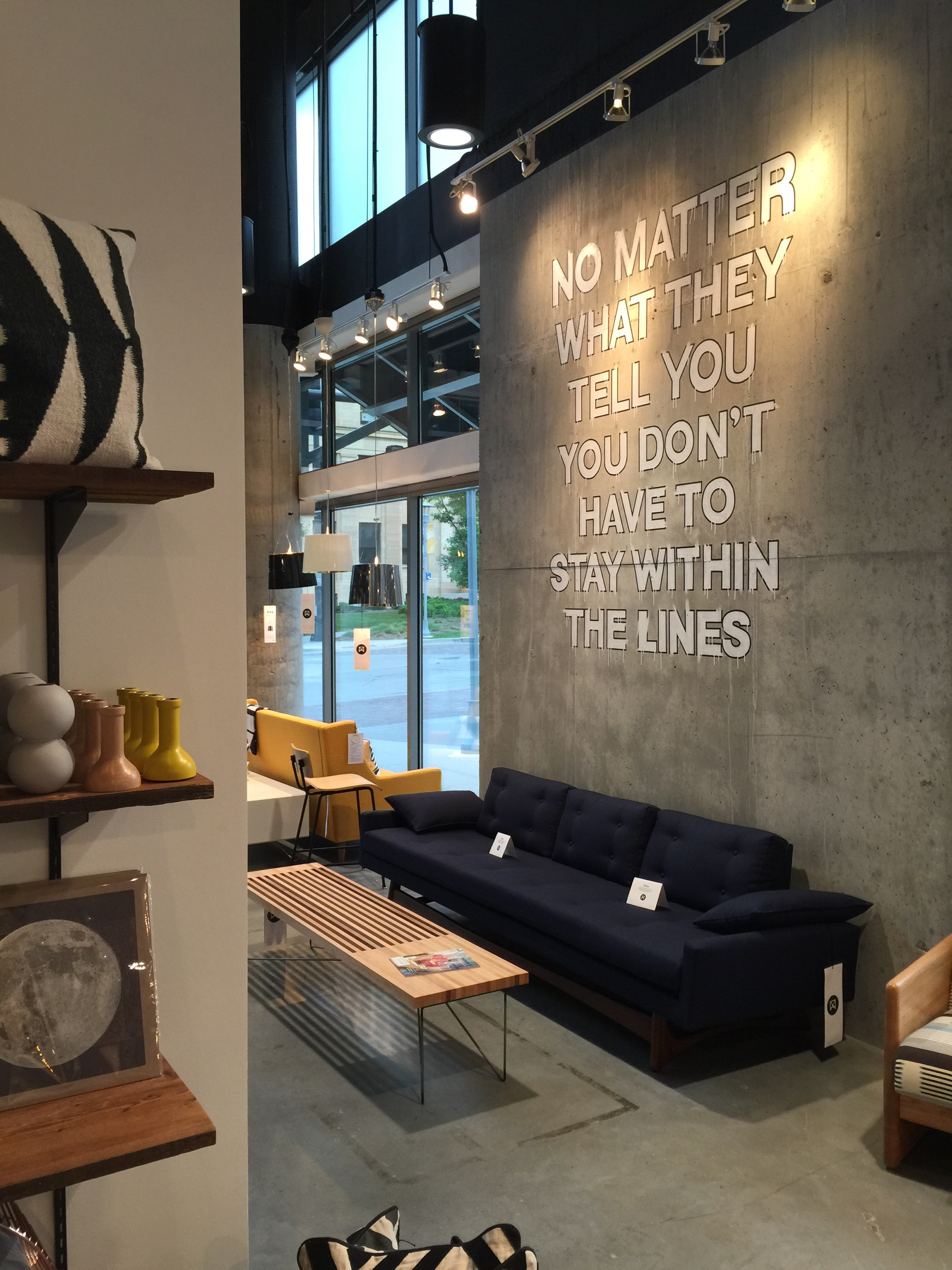 Hutch sells modern rustic and contemporary furniture in midtown omaha toward the entrance of the store this displayed in bold letters on the wall